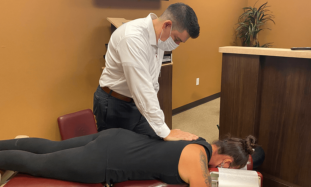 Chiropractor Dr. Dean Mammales Royal Palm Beach Chiropractor Adjusting Patient